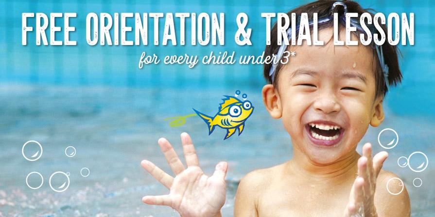 Happy child under 3 splashing in a pool